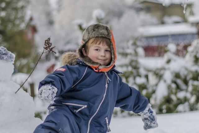 Cute boy in Finnish winterland